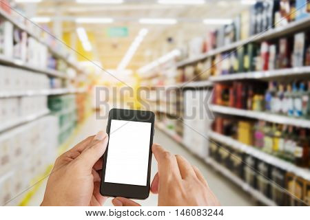 Hand man holding smart phone white screen on blurred shopping mall or blurred shopping store and department store