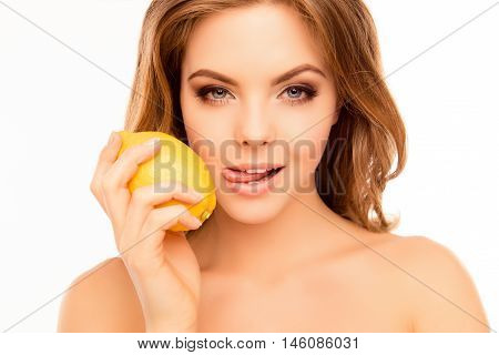 Pretty Young Woman With Lemon Licking Her Lips
