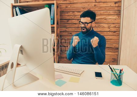 Happy Businessman In Glasses Triumphing With Raised Fists And Screaming