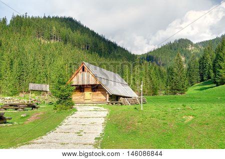 Wooden hut in beautiful mountain valley in Western Tatra Poland.