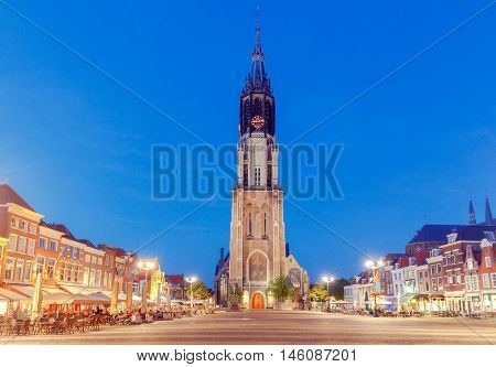 The central market square and  new church with a bell tower in the city Delft on sunset. Netherlands.
