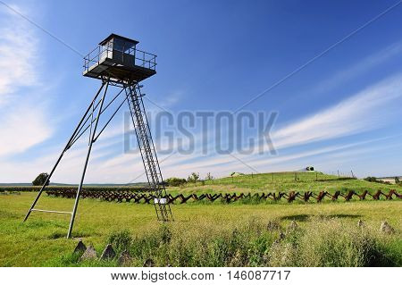 Watchtower And Line Of Defense, Old State Border Of The Iron Curtain - Barbed Fence. Memorial Milita