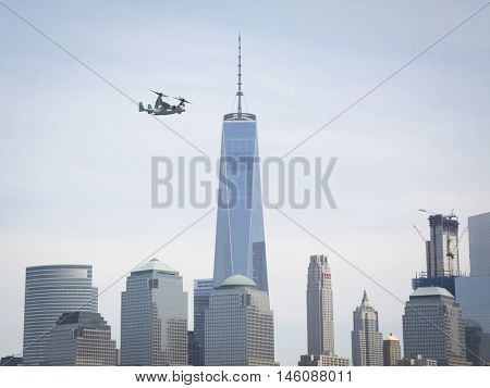 JERSEY CITY NJ MAY 29 2016: A U.S. Marine Corps MV-22 Osprey tiltrotor aircraft flies past the Freedom Tower along the Hudson River towards the Upper New York Bay during Fleet Week NY 2016.