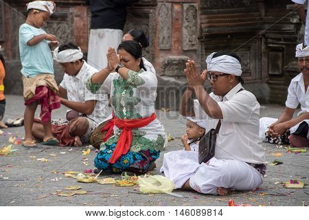 Pura Tirta Empul, Bali, Indonesia - August 17, 2016 - Balinese People At The Temple For Full Moon Ce