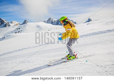Teenager ski rider on fresh powder snow on slope in Italy, San Martino di Castrozza., Dolomites