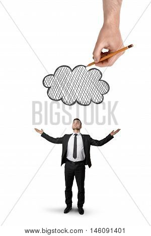 Back view of a businessman stands with raised hands and big hand above that draws a cloud isolated on white background. Problems and troubles at work. Business staff.