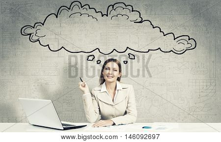 Thoughtful businesswoman sitting at table and thought cloud above her head