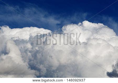 High Cumulus Clouds On A Blue Sky