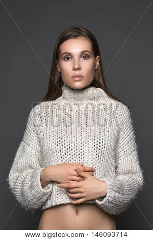 fashion girl in the white sweater closeup fashion and beauty