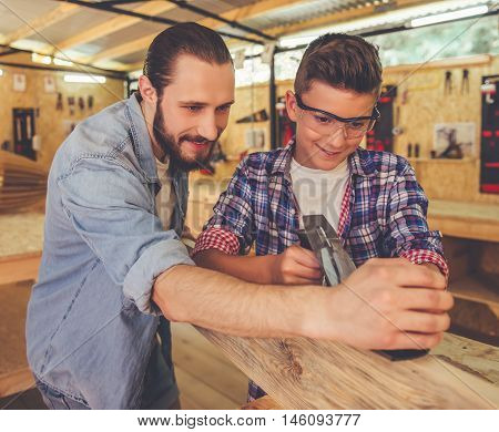 Father And Son Working With Wood