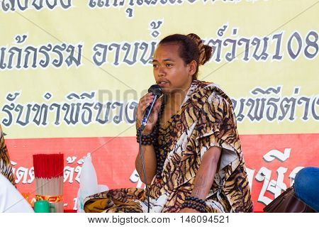 CHIANG RAI THAILAND - SEPTEMBER 1 : unidentified hermit in tiger-skin suit holding microphone on September 1 2016 in Chiang rai Thailand.