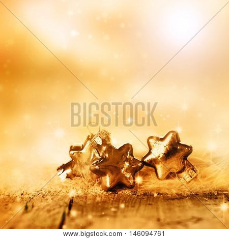 Wintry background with golden and silver christmas stars