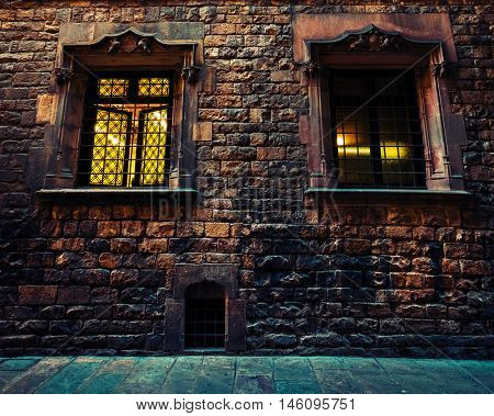 Facade of ancient stone building with windows, Barcelona, Spain