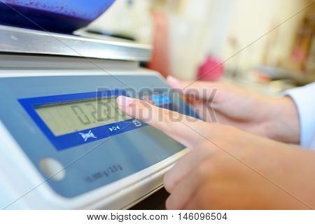 pressing the weighing scale