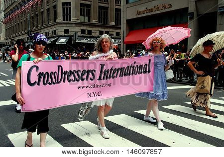 New York City - June 30 2007: Cross Dressers International marchers with their banner at the 2007 Gay Pride Parade on Fifth Avenue