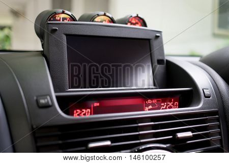 Luxury Sport Car with foldable TV screen on front console.