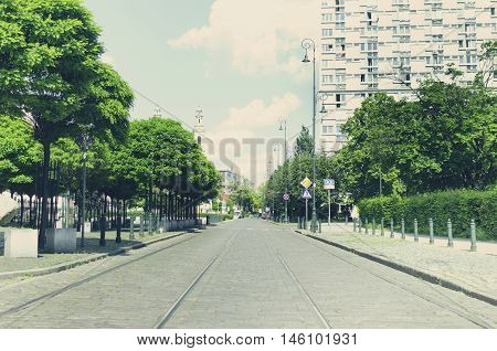 City street with tramway ways; Picturesque urban landscape; Vintage filter effect