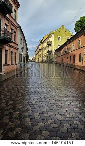 Uzupis district in Vilnius wet street after thunderstorm
