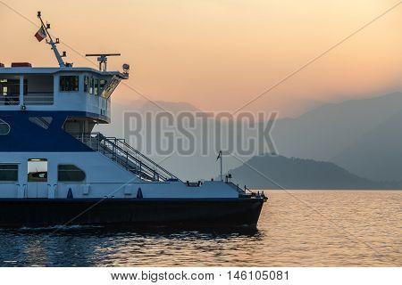 Ferry leaving small town Bellagio in the direction of Cadenabbia and Menaggio at Lake Como, Italy
