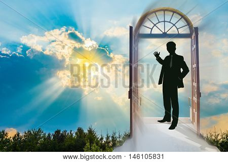 Beautiful sky background at sunset, with a man in a doorway, making the invitation gesture towards a brighter future