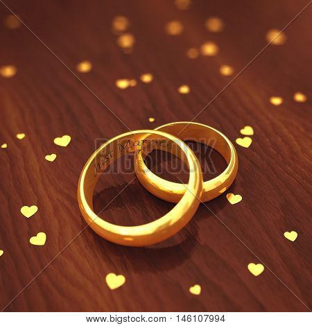 Engraved golden wedding rings on wooden defocused background , Valentine's day , Wedding