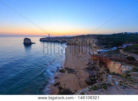 Sea Coast Sunset Landscape And Lighthouse.