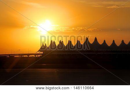 Denver airport against sun set background