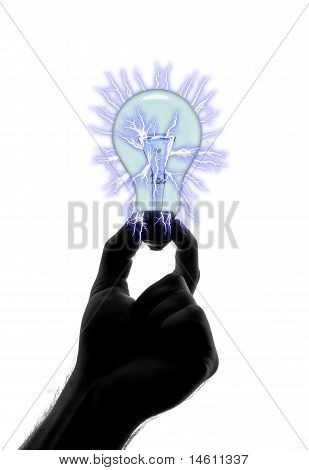 Silhouette Of Hand Holding Bulb With Lightnings