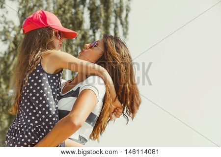Love and good feelings in family. Childhood and parenthood concept. Lovely cute girl and woman in summer holidays. Adorable mommy and her child daughter together.