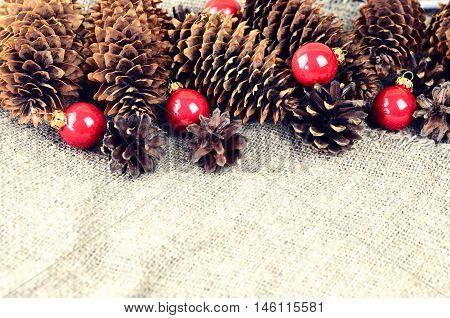 Pine And Spruce Cones And Red Christmas Balls. Christmas Decoration