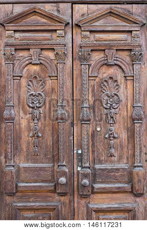 Ancient old entrance door looking like shabby chic texture background