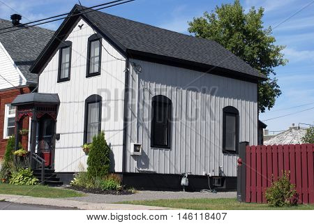 A black and white house from street view.