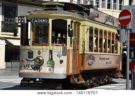 PORTO, PORTUGAL - AUG 22: Tram in Porto, Portugal, as seen on Aug 22, 2016. Porto has three regular heritage tram routes and they all use vintage tramcars exclusively.