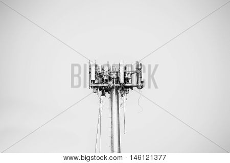 Men working on installing a cell phone tower