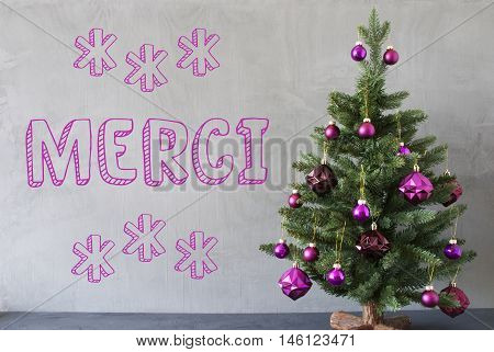 Christmas Tree With Purple Christmas Tree Balls. Card For Seasons Greetings. Gray Cement Or Concrete Wall For Urban, Modern Industrial Styl. French Text Merci Means Thank You