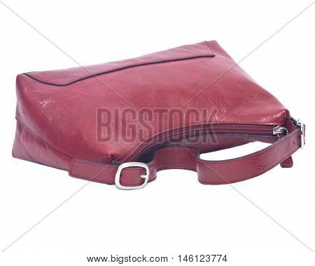 Attractive leather red purse on white background