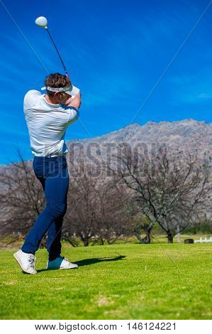 View Of A Golfer Teeing Off From A Golf Tee