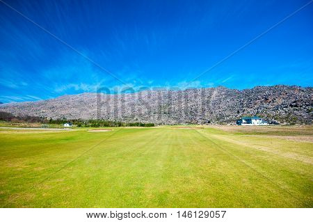 golf south african course with mountain background