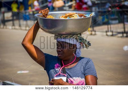BARRANQUILLA, COLOMBIA - FEBRUARY 15, 2015: Street vendors in Colombia's most important folklore celebration, the Carnival of Barranquilla, Colombia