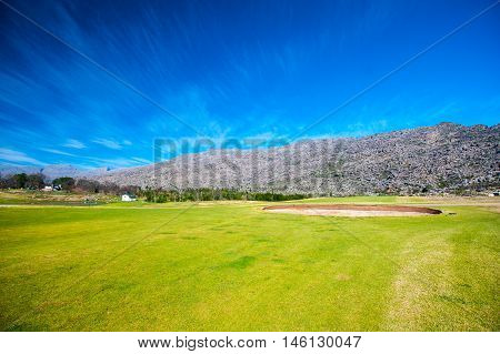 South African golf course with mountain background