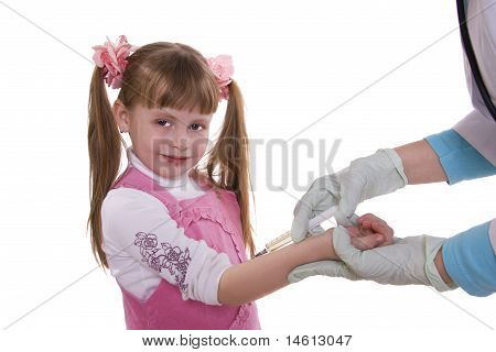 A doctor giving little girl an injection