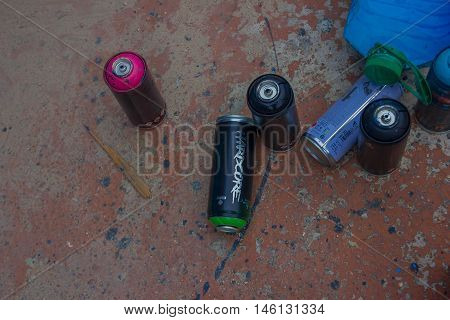 PUNTA DEL ESTE, URUGUAY - MAY 06, 2016: used spray cans lying in the street after painting.