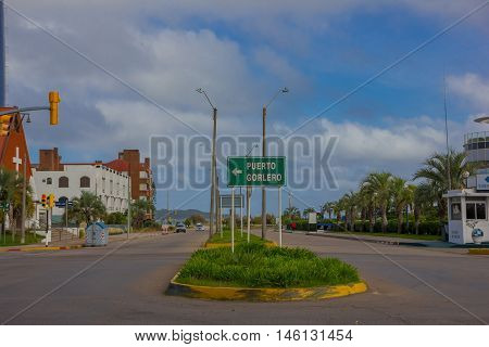 PUNTA DEL ESTE, URUGUAY - MAY 06, 2016: empty street with a signal of puerto gorlero in the middle.