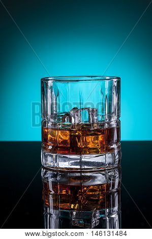 Close up of glass of spirits. A glass of liquor in a studio setting.