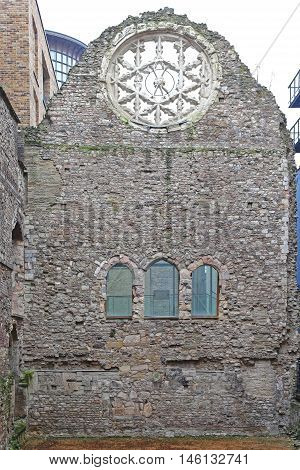 LONDON UNITED KINGDOM - JANUARY 19: Winchester Palace Ruins in London on JANUARY 19 2013. The Remains of Winchester Palace and Rose Window at Southwark in London United Kingdom.