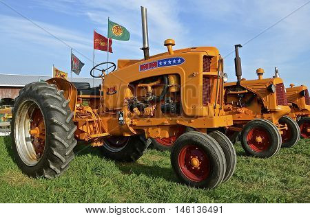 ROLLAG, MINNESOTA, Sept 1, 2016: Minneapolis Moline restored tractors are displayed at the West Central Steam Threshers Reunion(WCSTR) where 1000s attend each Labor Day weekend in Rollag, MN each year.