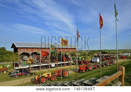 ROLLAG, MINNESOTA, Sept 1, 2016: Tractors of many models and flags are displayed at the West Central Steam Threshers Reunion (WCSTR) where 1000s attend each Labor Day weekend in Rollag, MN each year.