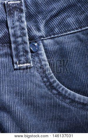 A fragment of denim corduroy trousers closeup