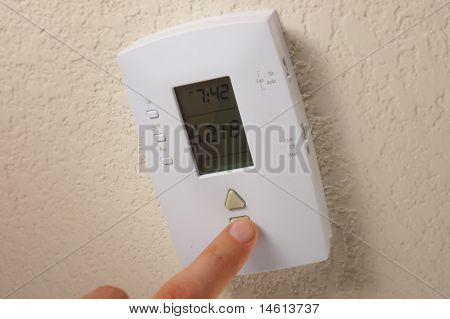 Conceptual Thermostat Saving Money