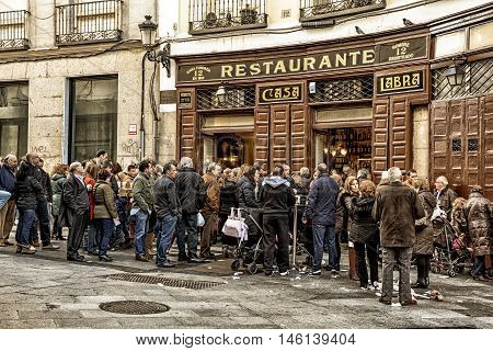 Madrid-December 8: People standing near famous restaurant